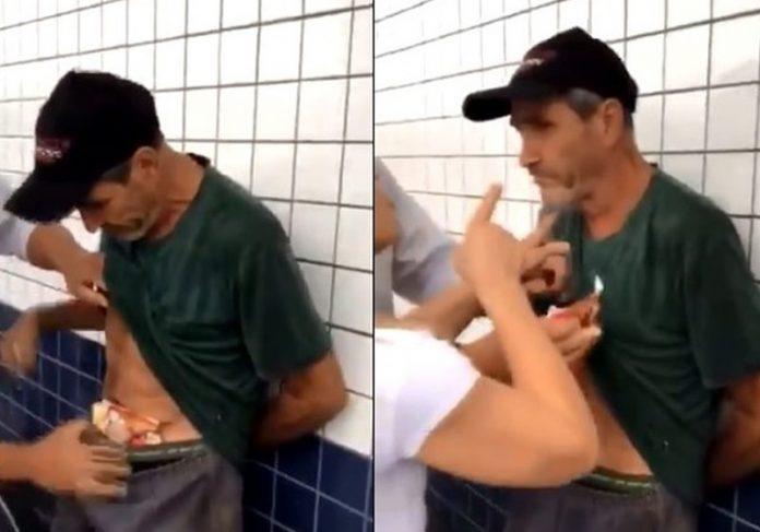 Vanderlei com a comida e sendo agredido - Foto: Reprodução/Twitter||