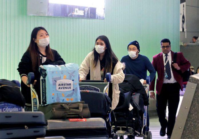 Chineses no aeroporto - Foto: Ringo Chiu|Foto: Ringo Chiu