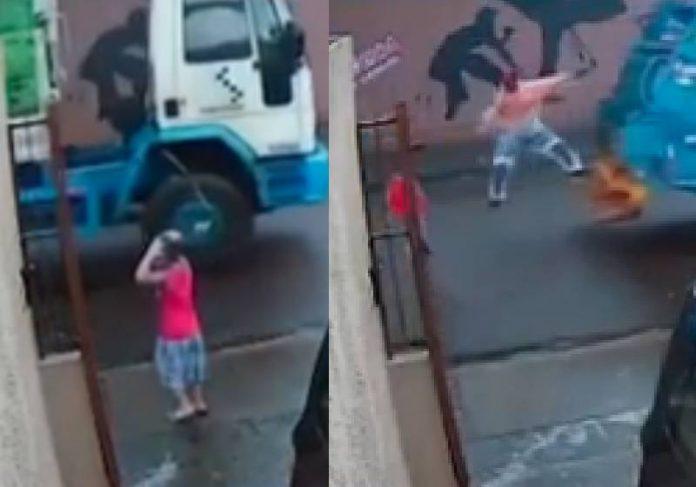 O coletor de lixo Kevin se encontrou com o menino que salvou de um atropelamento no PR - Fotos: câmera de segurança