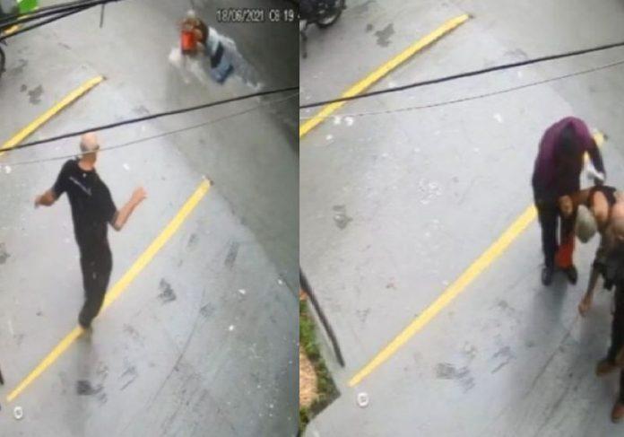 O bombeiro salvando a idosa levada pela enxurrada em Fortaleza - Fotos: câmeras de segurança