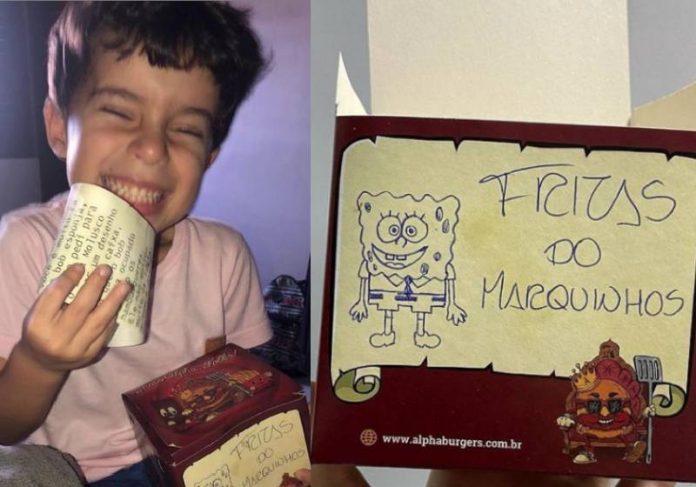 Marquinhos ficou todo feliz com o hambúrguer personalizado do Bob Esponja - Fotos: Instagram